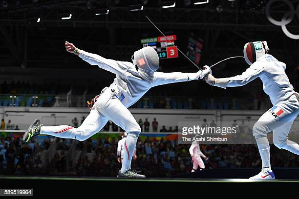 Kazuyasu Minobe of Japan and Gauthier Grumier of France compete in the Men's Epee Individual Quarterfinal on Day 4 of the Rio 2016 Olympic Games on...