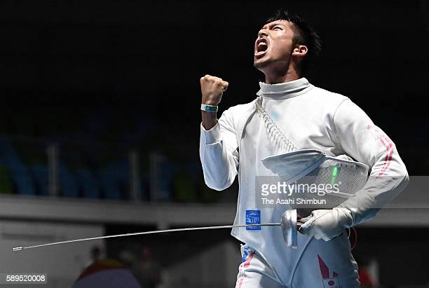 Kazuyasu Minobe of Japan celebrates winning against Anton Avdeev of Russia in the Men's Epee Individual Table of 16 match on Day 4 of the Rio 2016...