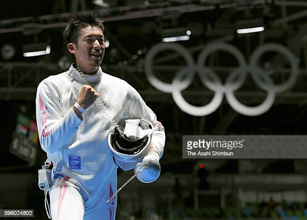 Kazuyasu Minobe of Japan celebrates winning against Marco Fichera of Italy in the Men's Epee Individual Table of 32 match on Day 4 of the Rio 2016...