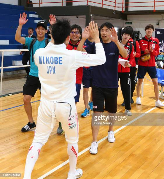 Kazuyasu Minobe of Japan celebrates with teammates after winning the gold medal during the team competition at the Men's Epee World Cup on March 24...