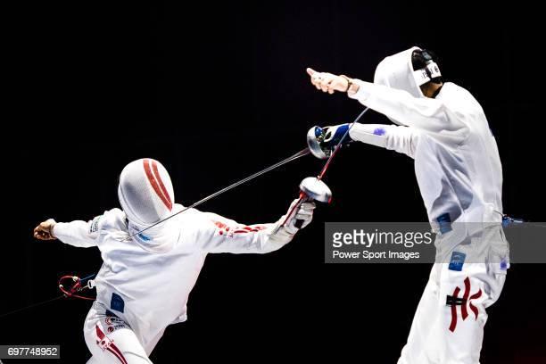 Kazuyasu Minobe of Japan fences Sze Hou Ho of Hong Kong during the Asian Fencing Championships 2017 on June 19 2017 in Hong Kong Hong Kong