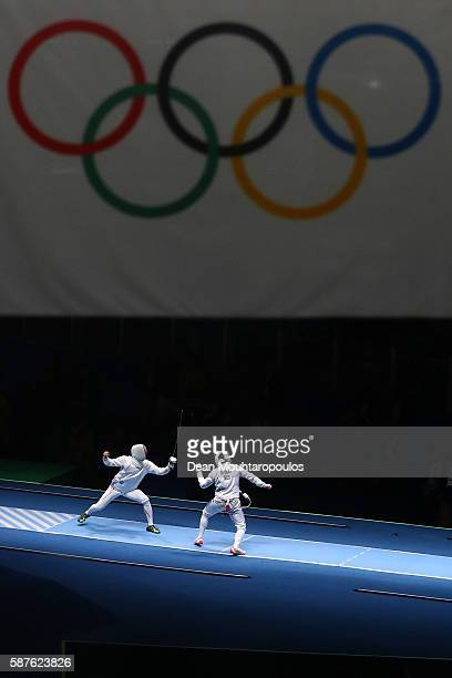 Kazuyasu Minobe of Japan in action against Gauthier Grumier of France in the Men's Epee Individual on Day 4 of the Rio 2016 Olympic Games on August 9...
