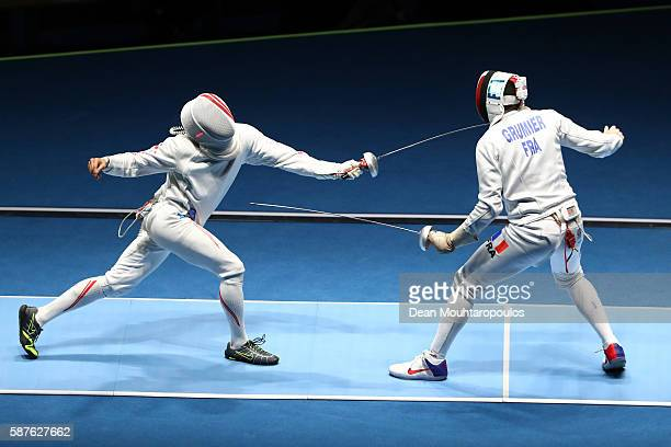 Kazuyasu Minobe of Japan in action against Gauthier Grumier of France during the quarterfinal in the Men's Epee Individual on Day 4 of the Rio 2016...