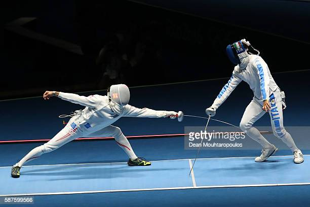 Kazuyasu Minobe of Japan in action against Marco Fichera of Italy during the Men's Epee Individual against on Day 4 of the Rio 2016 Olympic Games on...