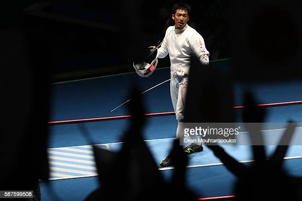 Kazuyasu Minobe of Japan reacts duing the match Marco Fichera of Italy during the Men's Epee Individual against on Day 4 of the Rio 2016 Olympic...