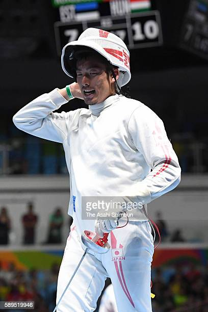 Kazuyasu Minobe of Japan shows his dejection after being defeated by Gauthier Grumier of France in the Men's Epee Individual Quarterfinal on Day 4 of...