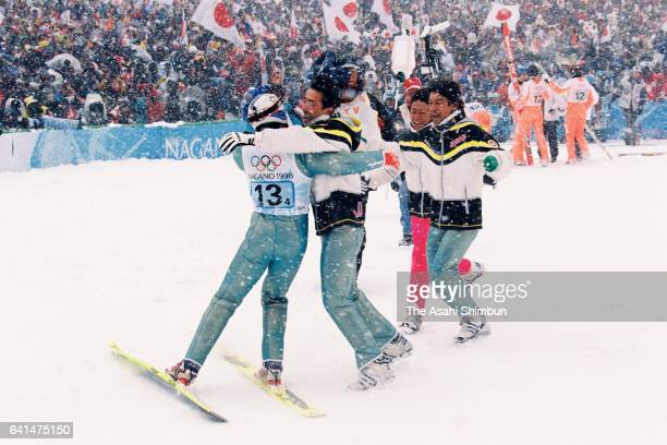 Kazuyoshi Funaki Masahiko Harada Takanobu Okabe and Hiroya Saito of Japan celebrate winning the gold medals in the Ski Jumping Team during day ten of...