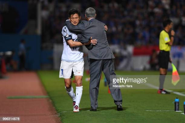 Kazuyoshi Miura and coachTavares of Yokohama FC hug during the Emperor's Cup third round match between Yokohama FMarinos and Yokohama FC at Nippatsu...