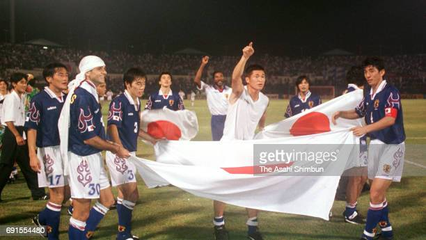 Kazuyoshi Miura and Japanese players celebrate the win after the France World Cup Asian Qualifier PlayOff match between Japan and Iran at Larkin...