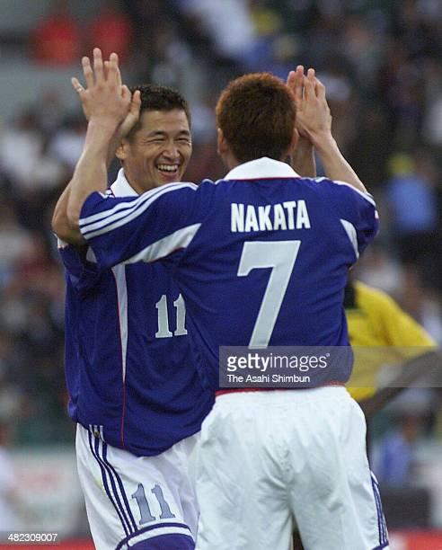 Kazuyoshi Miura of Japan celebrates scoring his team's fourth goal with his teammate Hidetoshi Nakata during the Hassan II Trophy international...