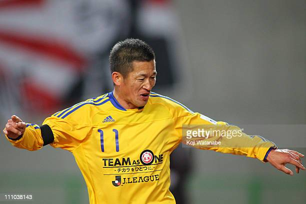 Kazuyoshi Miura of JLeague XI scores the third goal during a charity match for those affected by Japan's earthquake and tsunami at Nagai Stadium on...