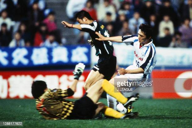 Kazuyoshi Miura of Verdy Kawasaki competes for the ball against Seigo Narazaki and Haruki Seto of Yokohama Flugels during the J.League first stage...