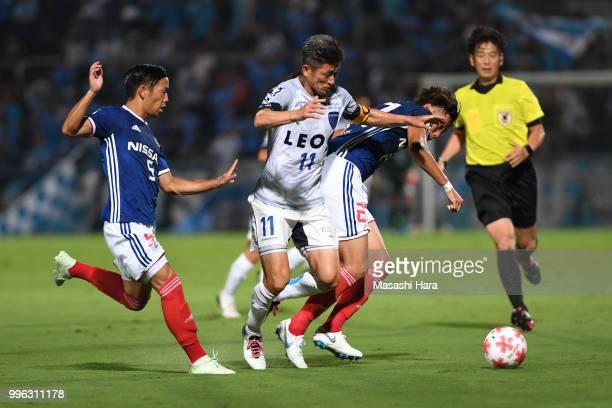 Kazuyoshi Miura of Yokohama FC and Ken Matsubara of Yokohama FMarinos compete for the ball during the Emperor's Cup third round match between...