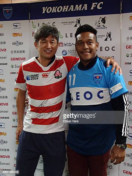 Kazuyoshi Miura of Yokohama FC meets Kotaro Matsushima player of rugby Japan after the JLeague second division match between Yokohama FC and Kyoto...