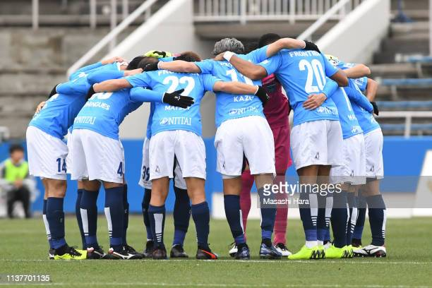 Kazuyoshi Miura of Yokohama FC participates as a starting member at the age of 52 and 25 days.Players of Yokohama FC make the huddle during the...