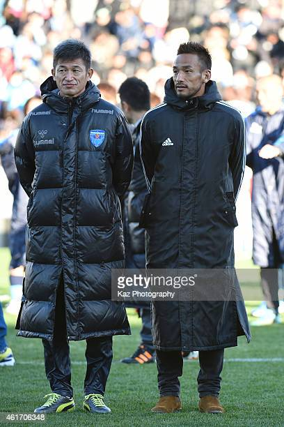 Kazuyoshi Miura of Yokohama Friends and Hidetoshi Nakata of J Amigos stand for Oku Memorial Ceremony during the Daisuke Oku Memorial Match between J...