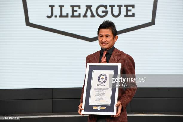 Kazuyoshi Miura poses for photographs with the Guinness World Record certificate as he is recognised as the 'Oldest professional football player to...