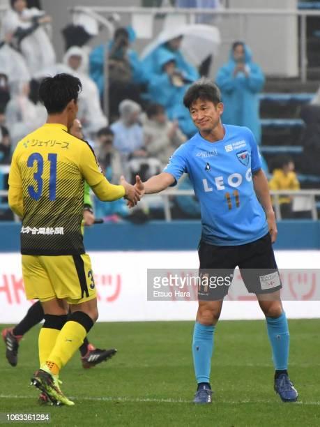 Kazuyoshi Miura shakes hands with Shun Takagi of Oita Trinita the JLeague J2 match between Yokohama FC and Oita Trinita at Nippatsu Mitsuzawa Stadium...