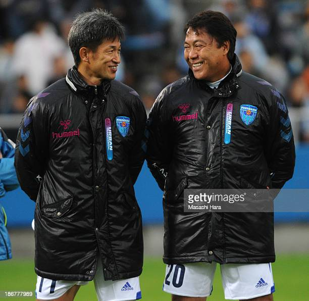 Kazuyoshi Miura speaks to Yasuhiko Okudera after the Atsuhiro Miura Retirement match at Nippatsu Mitsuzawa Stadium on November 4 2013 in Yokohama...