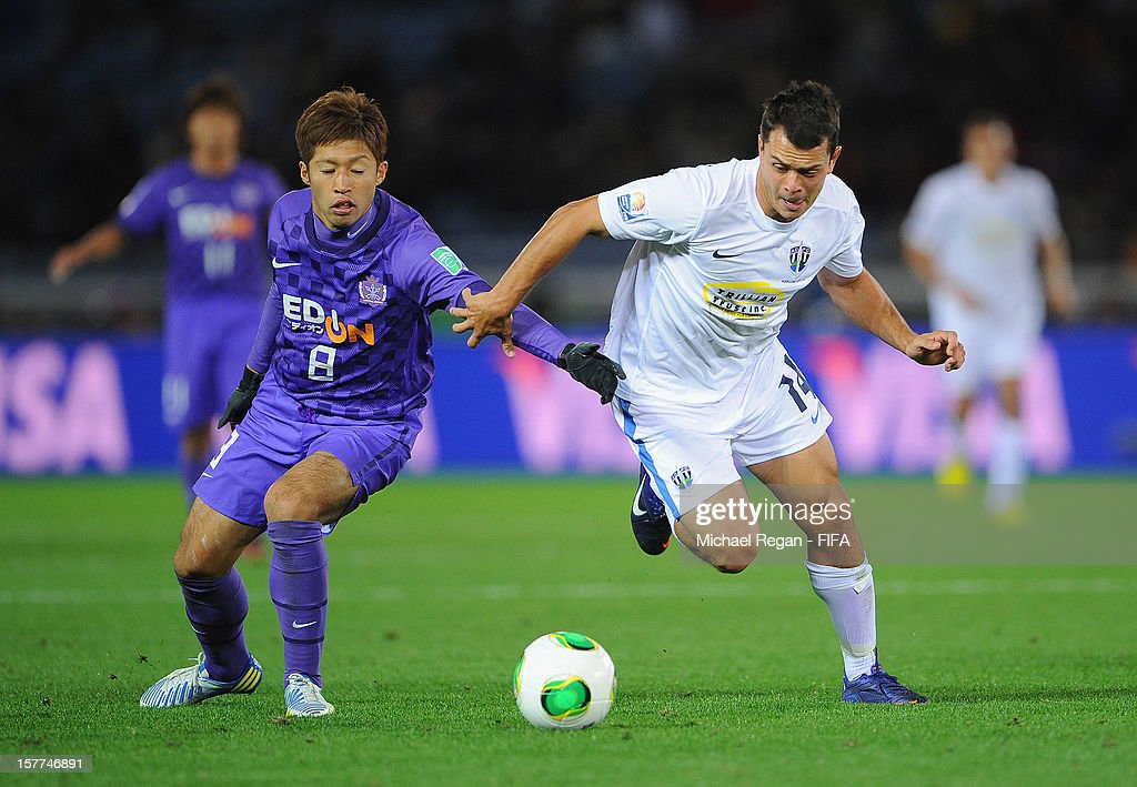 Kazuyuki Morisaki of Hiroshima in action with Adam Dickinson of Auckland during the FIFA Club World Cup match between Sanfrecce Hiroshima and Auckland City at International Stadium Yokohama on December 6, 2012 in Yokohama, Japan.