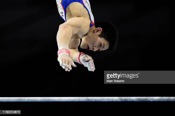 Kazuyuki Takeda of Japan competes on the Horizontal Bar during day two of the Artistic Gymnastics NHK Trophy at Musashino Forest Sport Plaza on May...