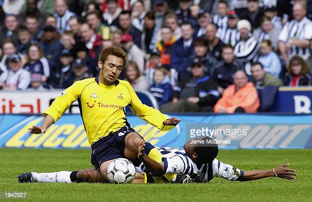 Kazuyuki Toda of Tottenham Hotspur battles with Ifeanyi Udeze of West Bromwich Albion during the FA Barclaycard Premiership match on April 21 2003...