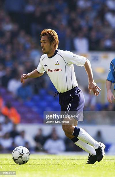 Kazuyuki Toda of Tottenham Hotspur runs with the ball during the FA Barclaycard Premiership match between Tottenham Hotspur and Manchester City held...