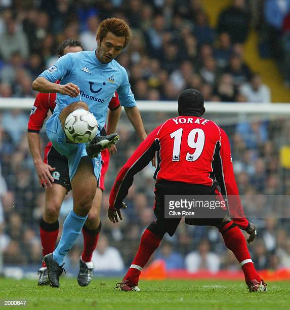 Kazuyuki Toda of Tottenham Hotspur takes control of the ball whilst under pressure from Dwight Yorke of Blackburn Rovers during the FA Barclaycard...