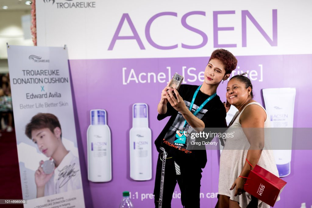 K-Beauty Vlogger Edward Avila takes a selfie with a fan at KCON 2018 LA at Los Angeles Convention Center on August 10, 2018 in Los Angeles, California.