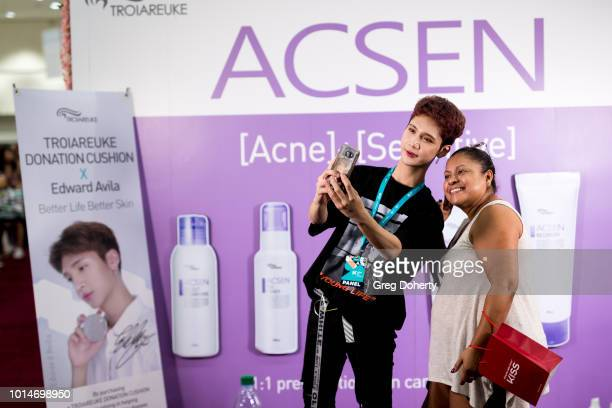 Beauty Vlogger Edward Avila takes a selfie with a fan at KCON 2018 LA at Los Angeles Convention Center on August 10 2018 in Los Angeles California