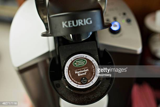 Cup coffee pack sits in a Keurig Green Mountain Inc. Machine in this arranged photograph taken at a retail store in Princeton, Illinois, U.S., on...