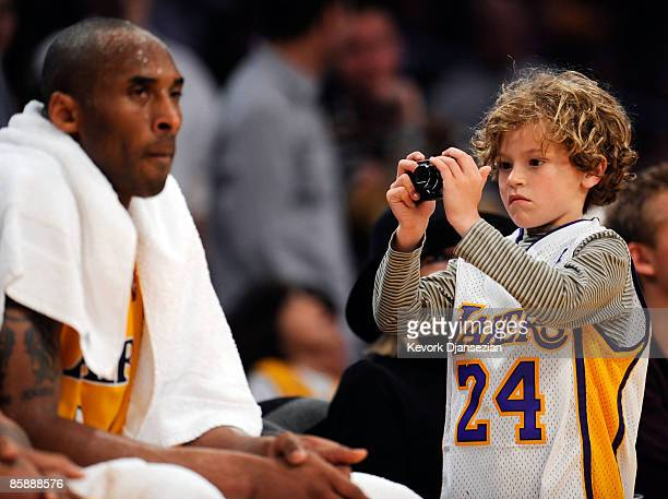KDuke Keaton son of actress Diane Keaton takes picture of Kobe Bryant of the Los Angeles Lakers during a break in the action against the Denver...