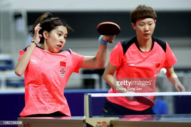 Ke Chen and Manyu Wang of China compete in the Women's Doubles Semifinals against Xingtong Chen and Yingsha Sun of China during day two of the World...