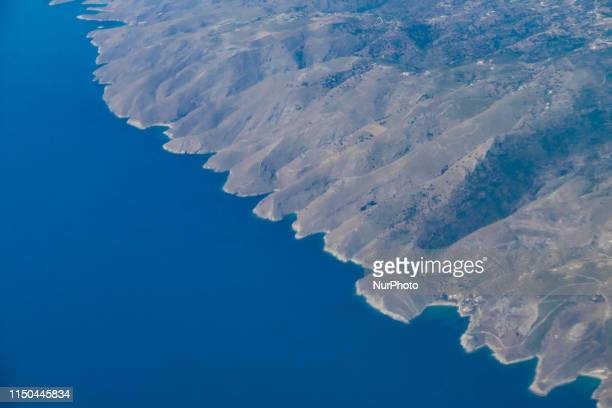 Kea or Tzia island as seen during a flight from a British Aerospace 146300 / Avro RJ airplane with registration SXDIZ of the Greek Astra Airlines AZI...