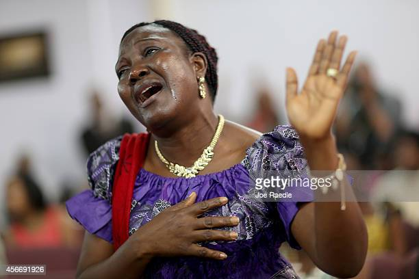 Keabeh Goyah whose son is a doctor in Liberia prays with other parishioners during a church service at New Life Fellowship Church on October 5, 2014...