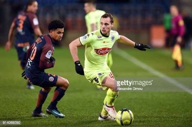 Keagan Dolly of Montpellier and Vincent Manceau of Angers during the Ligue 1 match between Montpellier and Angers at Stade de la Mosson on February 3...