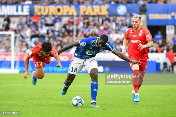 Keagan DOLLY of Montpellier Ibrahima SISSOKO of Strasbourg and Mihailo RISTIC of Montpellier during the Ligue 1 match between Strasbourg and...