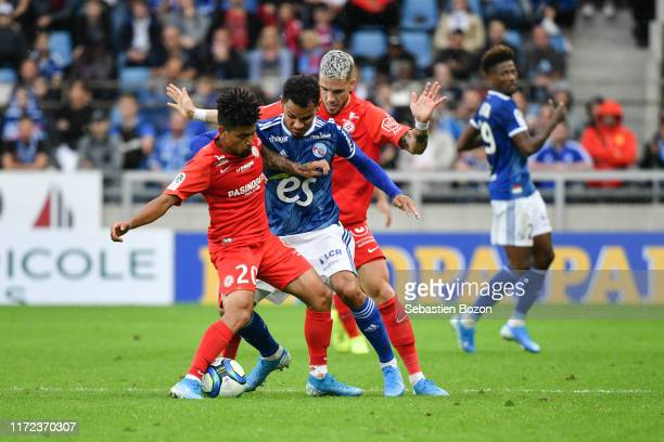 Keagan DOLLY of Montpellier Kenny LALA of Strasbourg and Mihailo RISTIC of Montpellier during the Ligue 1 match between Strasbourg and Montpellier on...