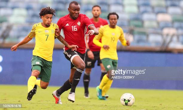 Keagan Dolly of South Africa challenges Almoatasembellah Ali Mohamed of Libya during the African Cup of Nations qualifier match on September 8 2018...