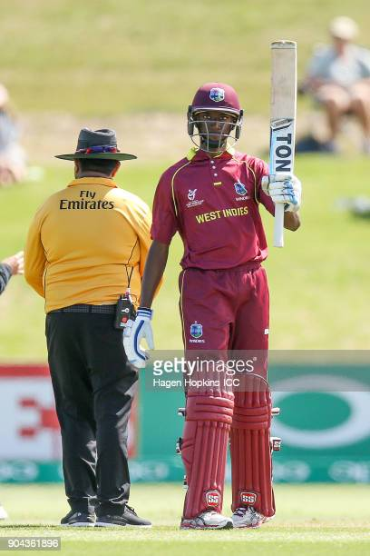 Keagan Simmons of the West Indies celebrates his half century during the ICC U19 Cricket World Cup match between New Zealand and the West Indies at...