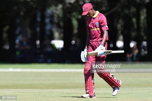 Keagan Simmons of the West Indies looks dejected after being run out during the ICC U19 Cricket World Cup match between the West Indies and Kenya at...