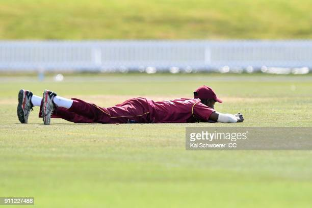 Keagan Simmons of the West Indies reacts after missing a catch during the ICC U19 Cricket World Cup Plate Final match between Sri Lanka and the West...