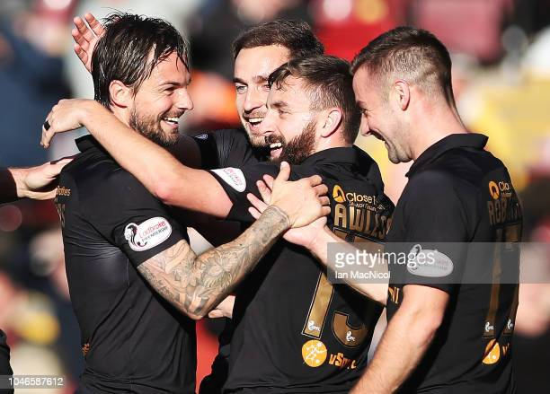 Keaghan Jacobs of Livingston is congratulated after scoring his team's first goal during the Ladbrokes Scottish Premiership match between Motherwell...