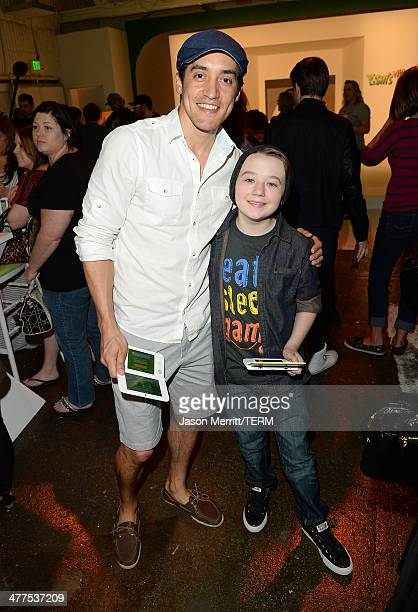 Keahu Kahuanui and Benjamin Stockham attend Yoshi's Celebrity Egg Decorating Eggsperience on March 9 2014 in Los Angeles California
