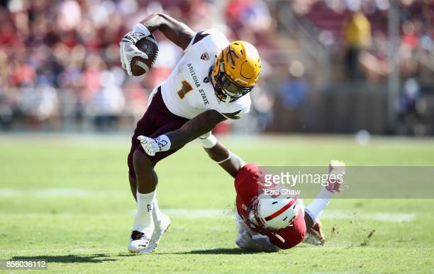 Keal Harry of the Arizona State Sun Devils tries to get away from Alameen Murphy of the Stanford Cardinal at Stanford Stadium on September 30 2017 in...