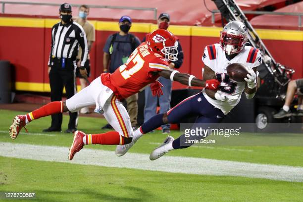 Keal Harry of the New England Patriots catches a touchdown pass ahead of Rashad Fenton of the Kansas City Chiefs during the second half at Arrowhead...