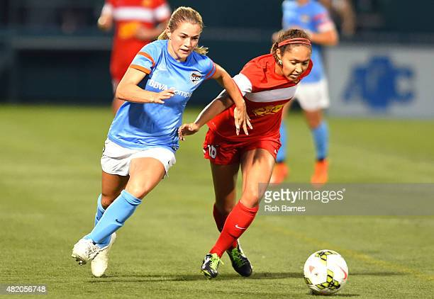 Kealia Ohai of the Houston Dash and Jaelene Hinkle of the Western New York Flash battle for a loose ball during the second half at Sahlen's Stadium...