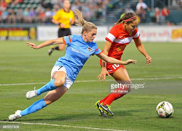Kealia Ohai of the Houston Dash loses her footing while battling Jaelene Hinkle of the Western New York Flash for the ball during the second half at...