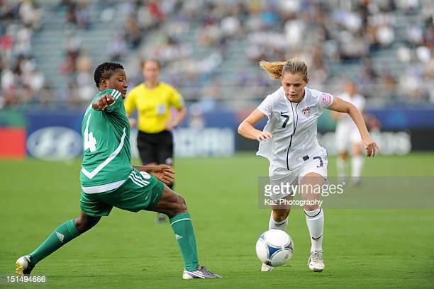 Kealia Ohai of USA and Ugo Njoku of Nigeria compete for the ball during the FIFA U20 Women's World Cup Japan 2012 Semi Final match between Nigeria...