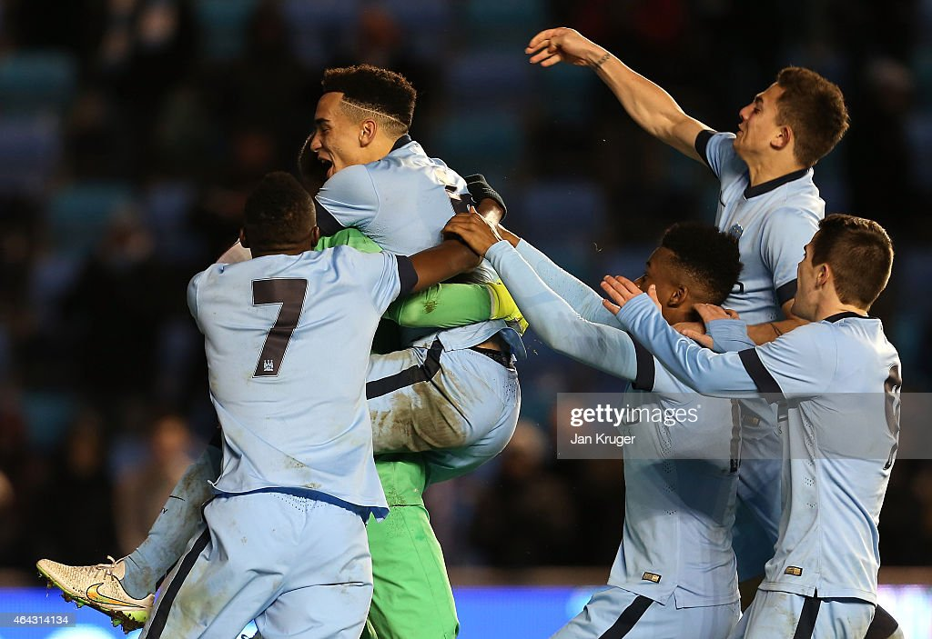 Kean Bryan and Angus Gunn, Goalkeeper of Manchester City celebrate winning on a penalty shoot out during the UEFA Youth League Round of 16 match between Manchester City FC and FC Schalke 04 at City Football Academy on February 24, 2015 in Manchester, England.